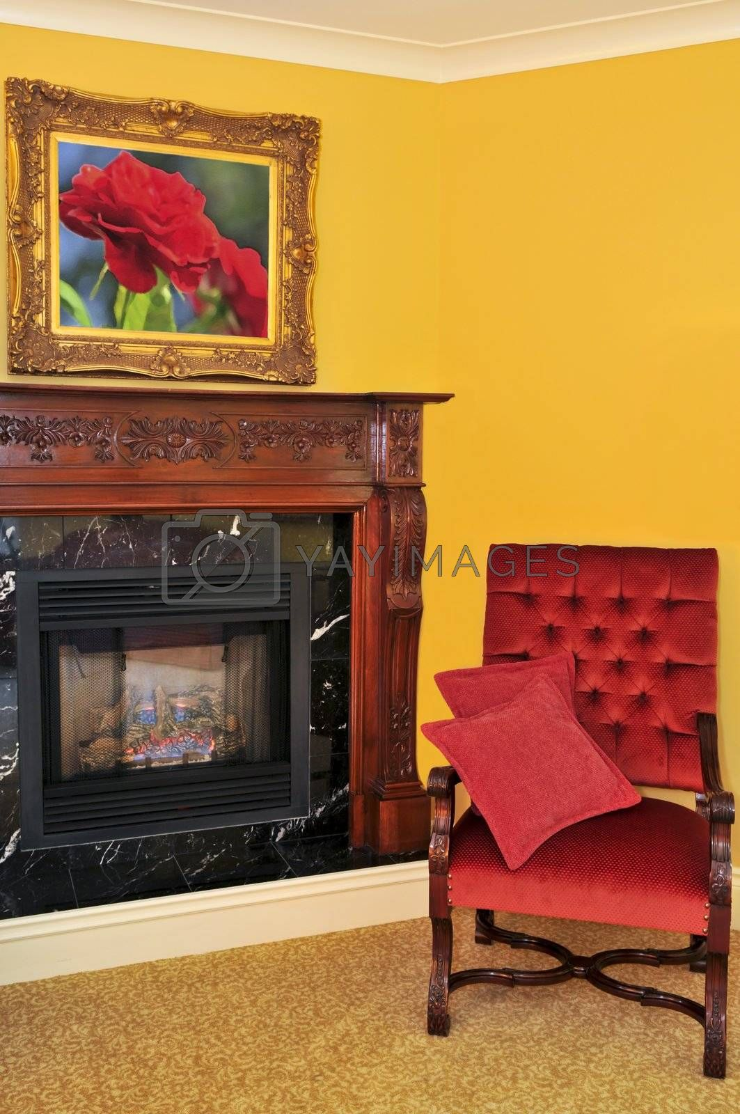 Fireplace and red chair by elenathewise