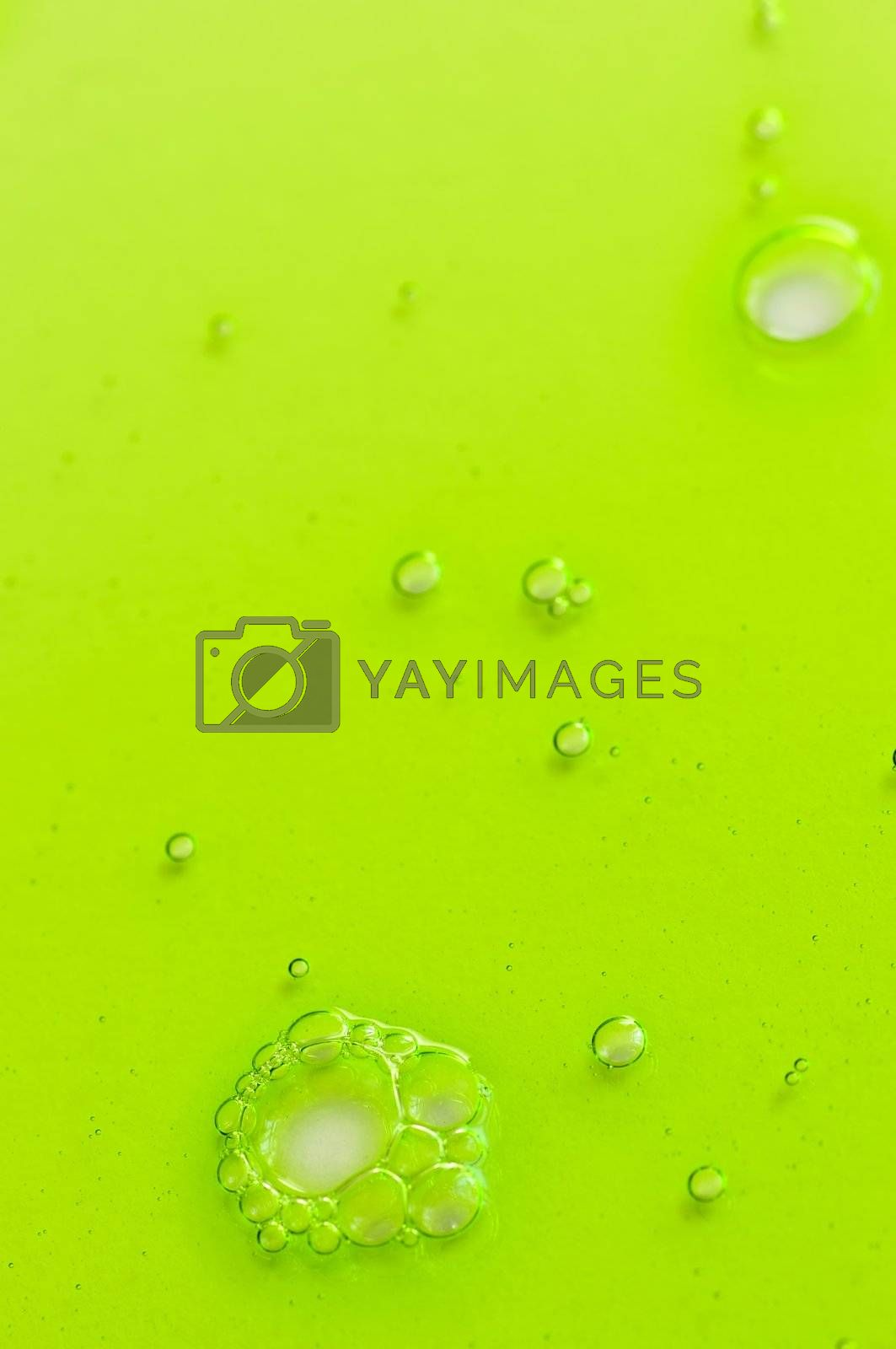 Abstract green gel liquid background with bubbles