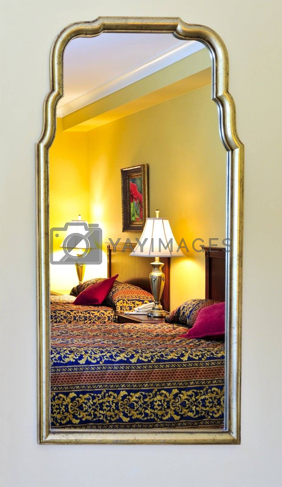 Bedroom interior reflected in mirror by elenathewise