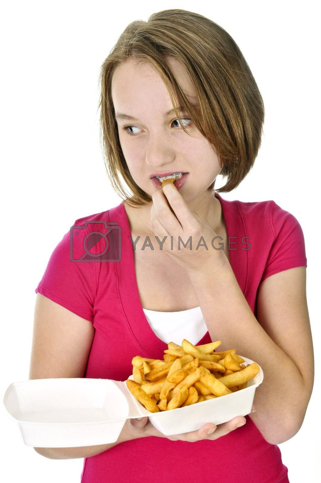 Teenage girl with french fries by elenathewise