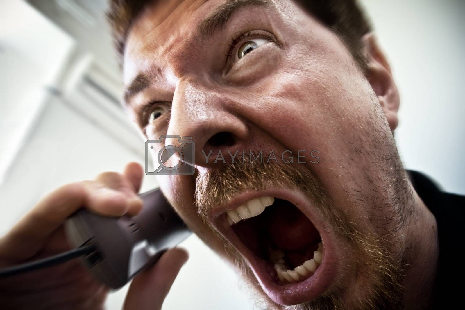 Man shouting at telephone by dundanim