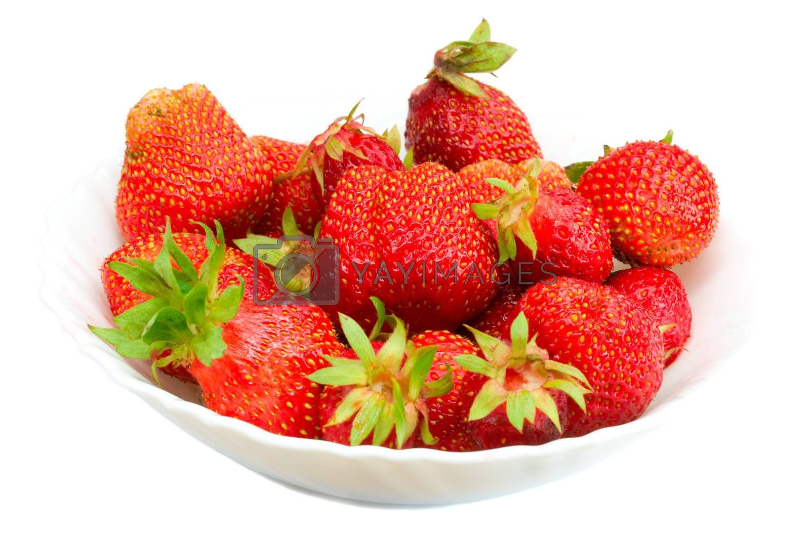 many strawberries on plate by Alekcey