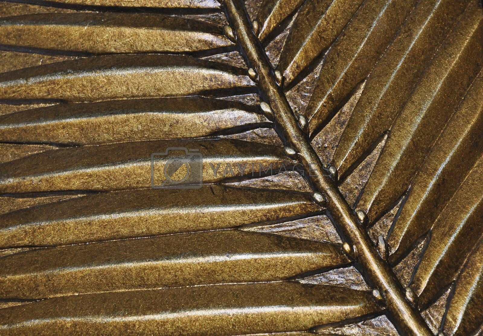 closeup view of gold metallic leaves artwork