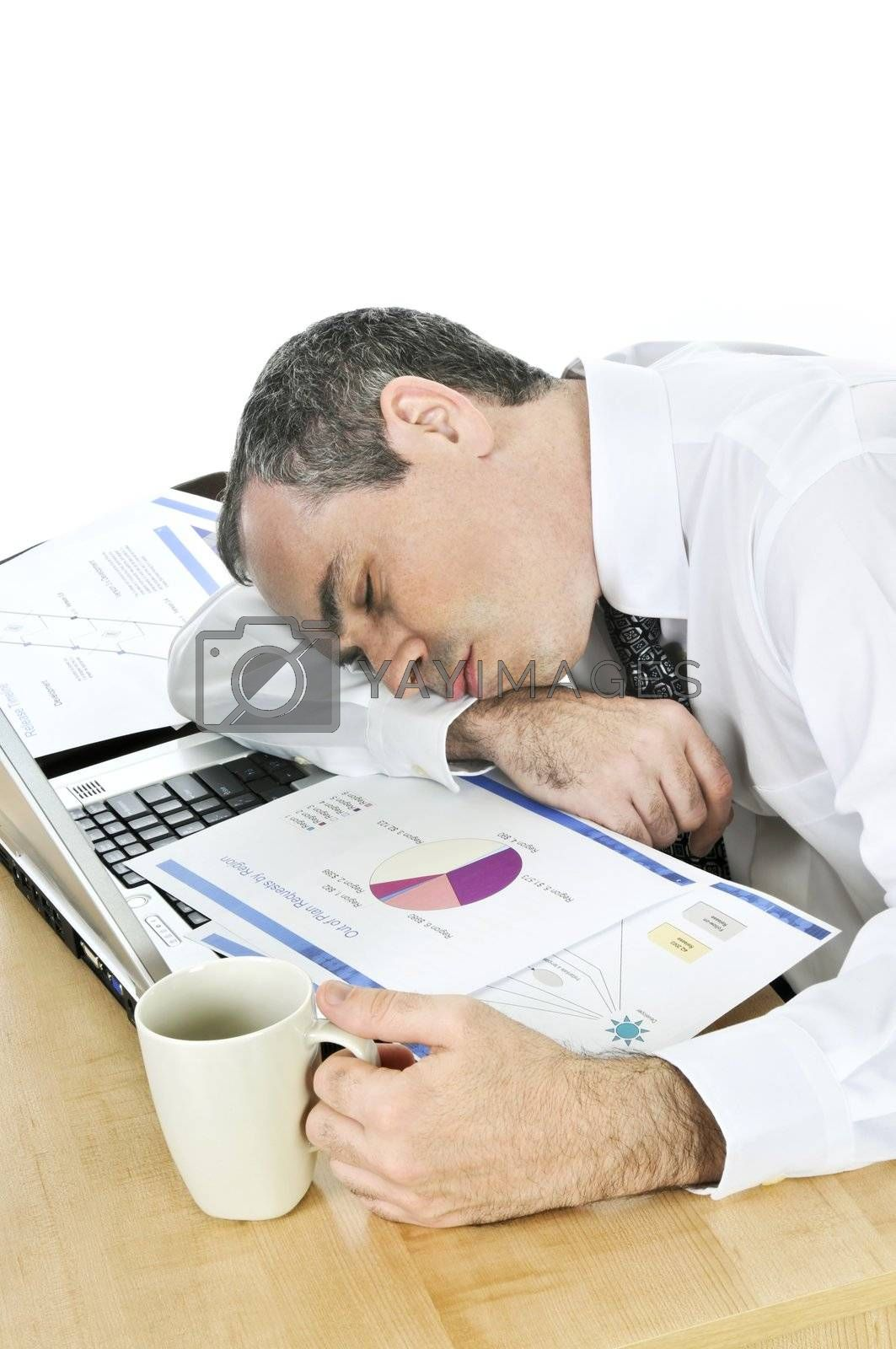 Businessman asleep at his desk on white background by elenathewise