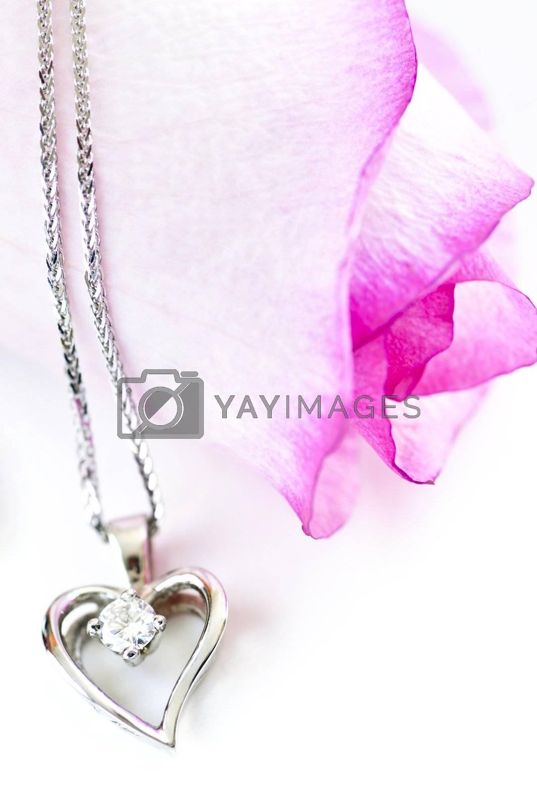 Diamond necklace on rose by elenathewise