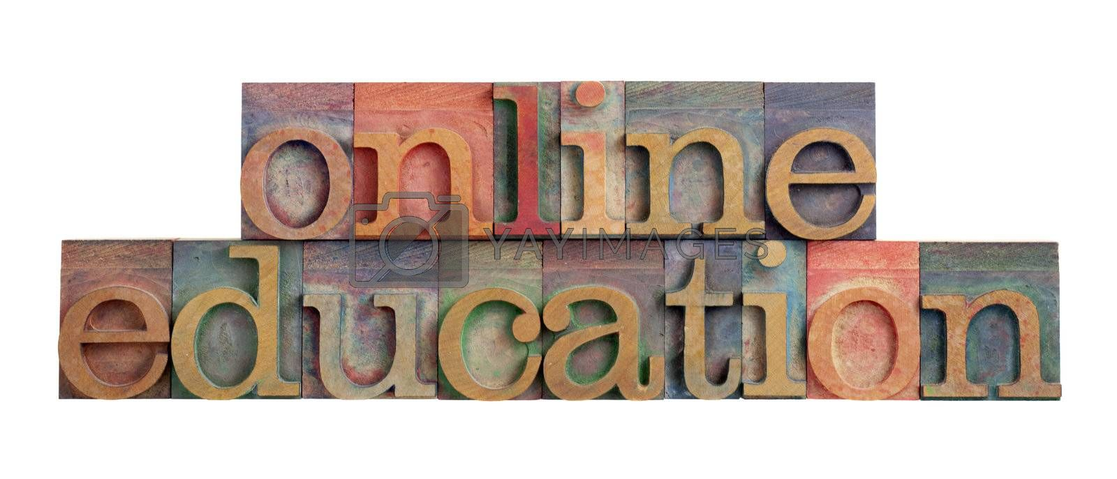 online education headline in vintage wooden letterpress type blocks, stained by color ink, isolated on white