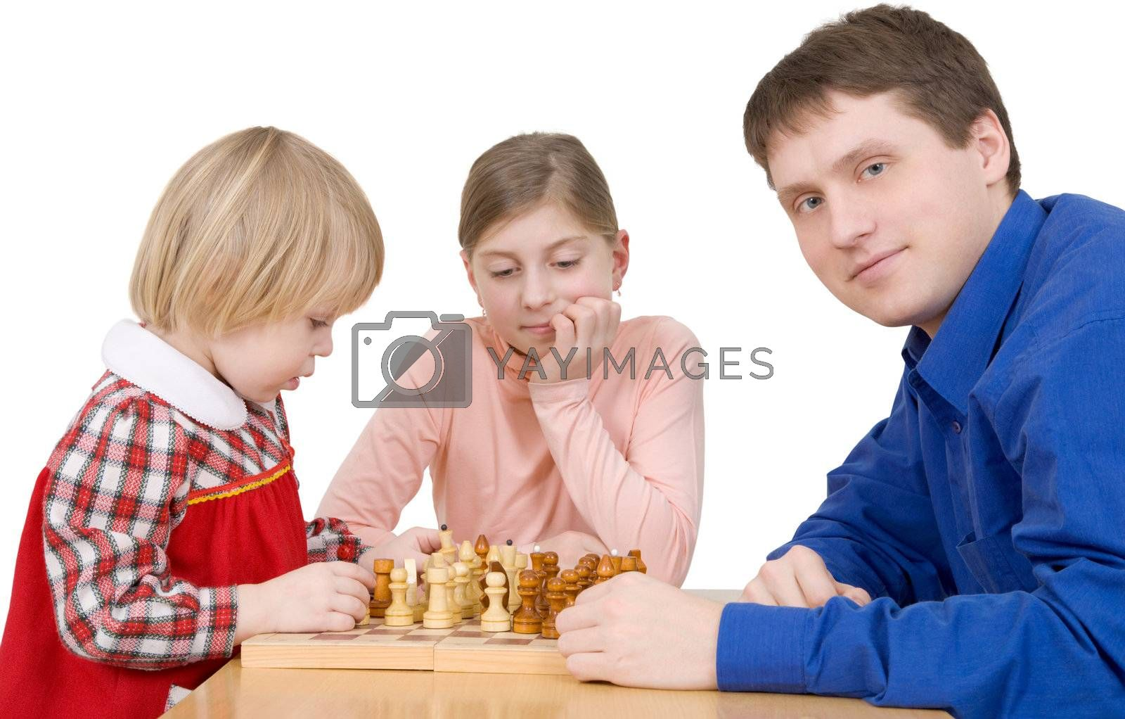 Royalty free image of Man and childs play to chess by pzaxe