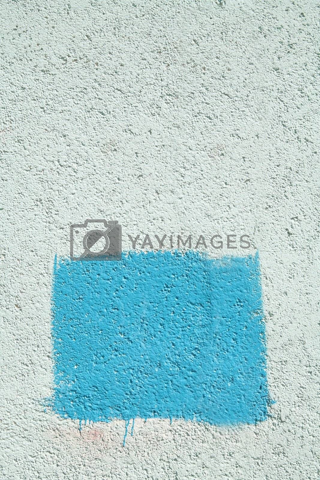 concrete wall with blue rectangle by Astroid