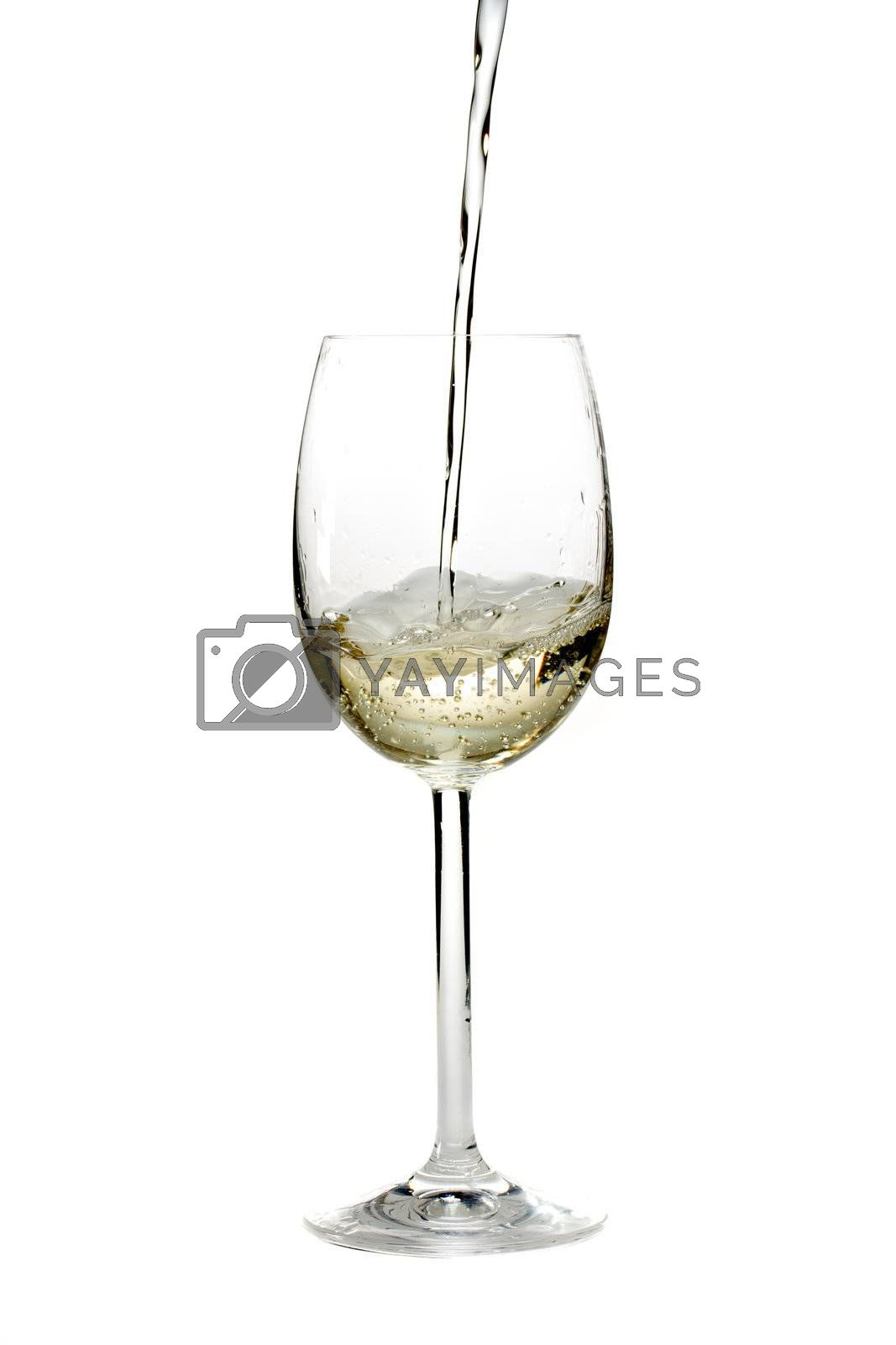 Royalty free image of pouring white wine in a glass over a white background by bernjuer