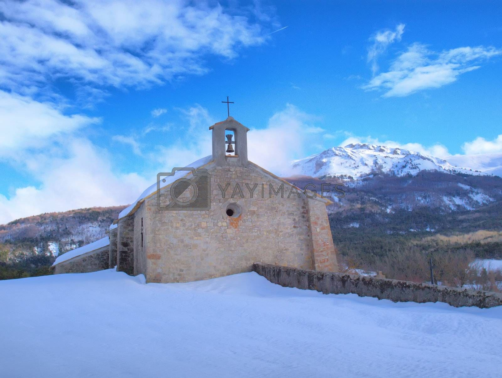 Royalty free image of Provence chapel in a snowy landscape by jbouzou