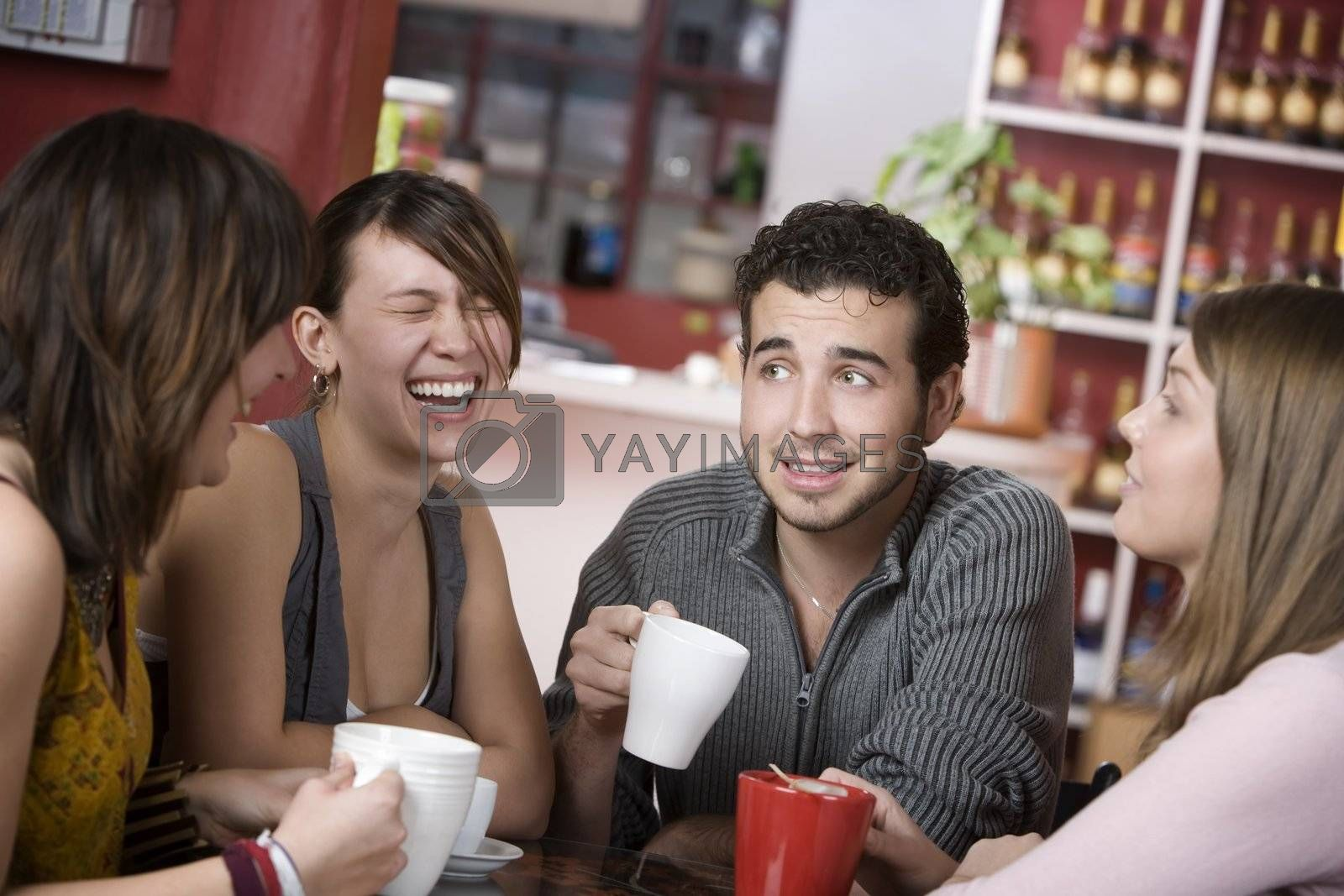 Royalty free image of Handsome Young Man Surrounded by Women by Creatista