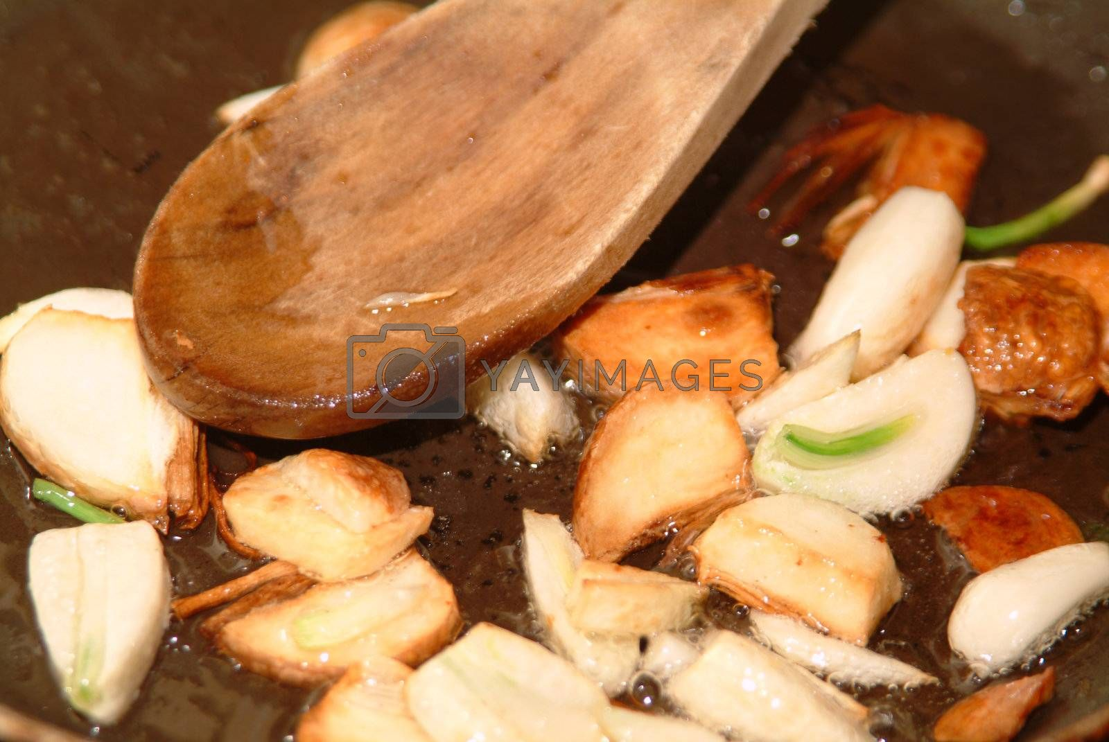 Royalty free image of garlic healthy spice by Szakaly