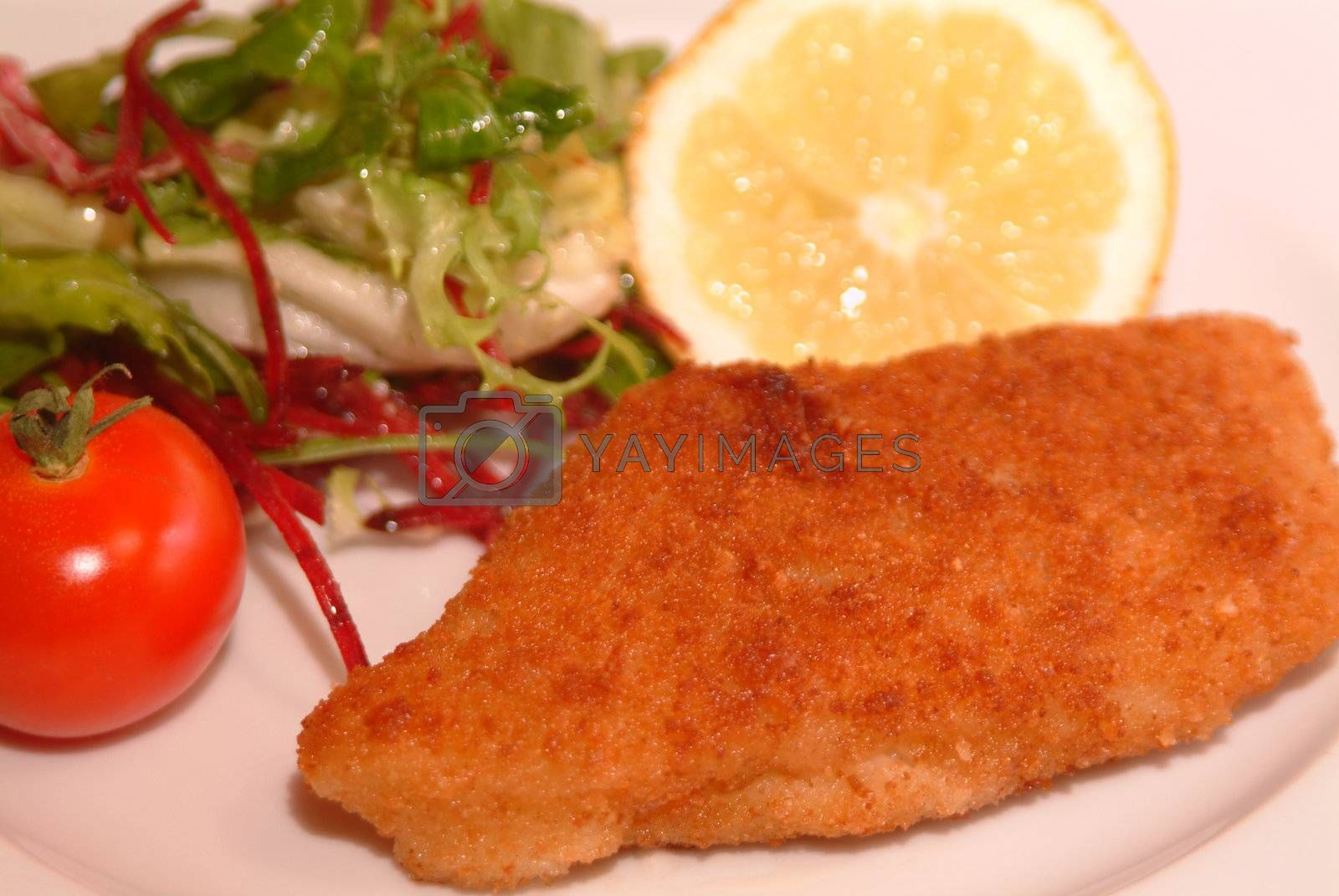 Royalty free image of fish filet with fresh salad by Szakaly