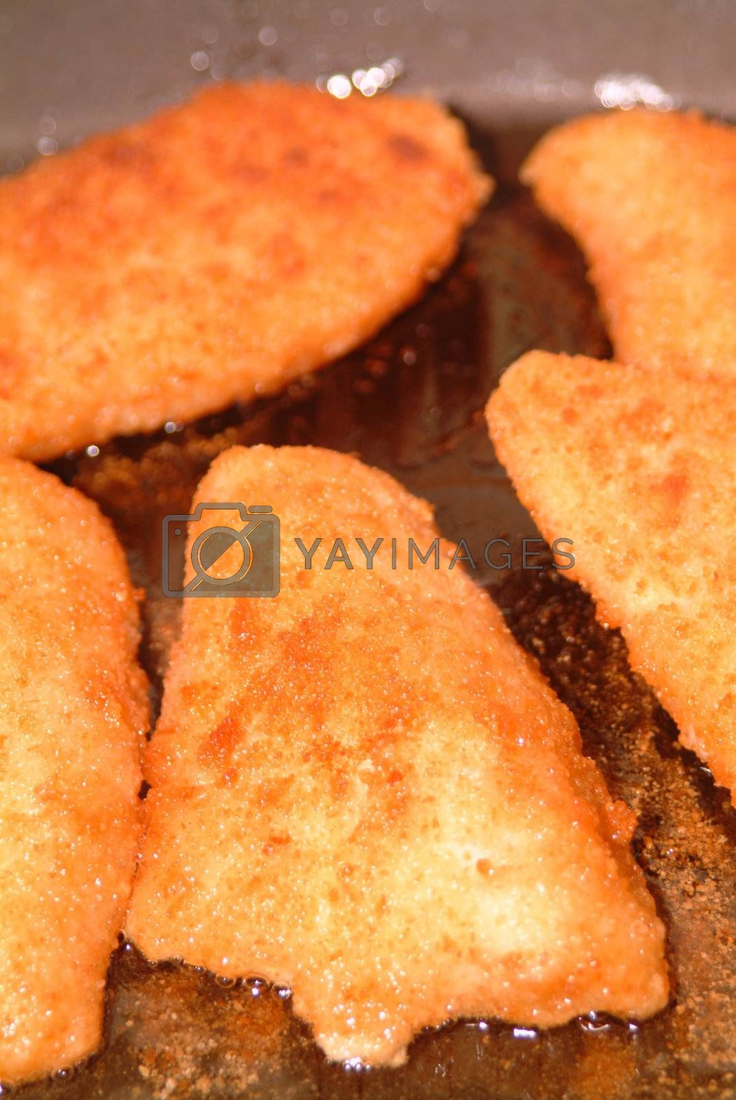Royalty free image of some fried fish filet by Szakaly