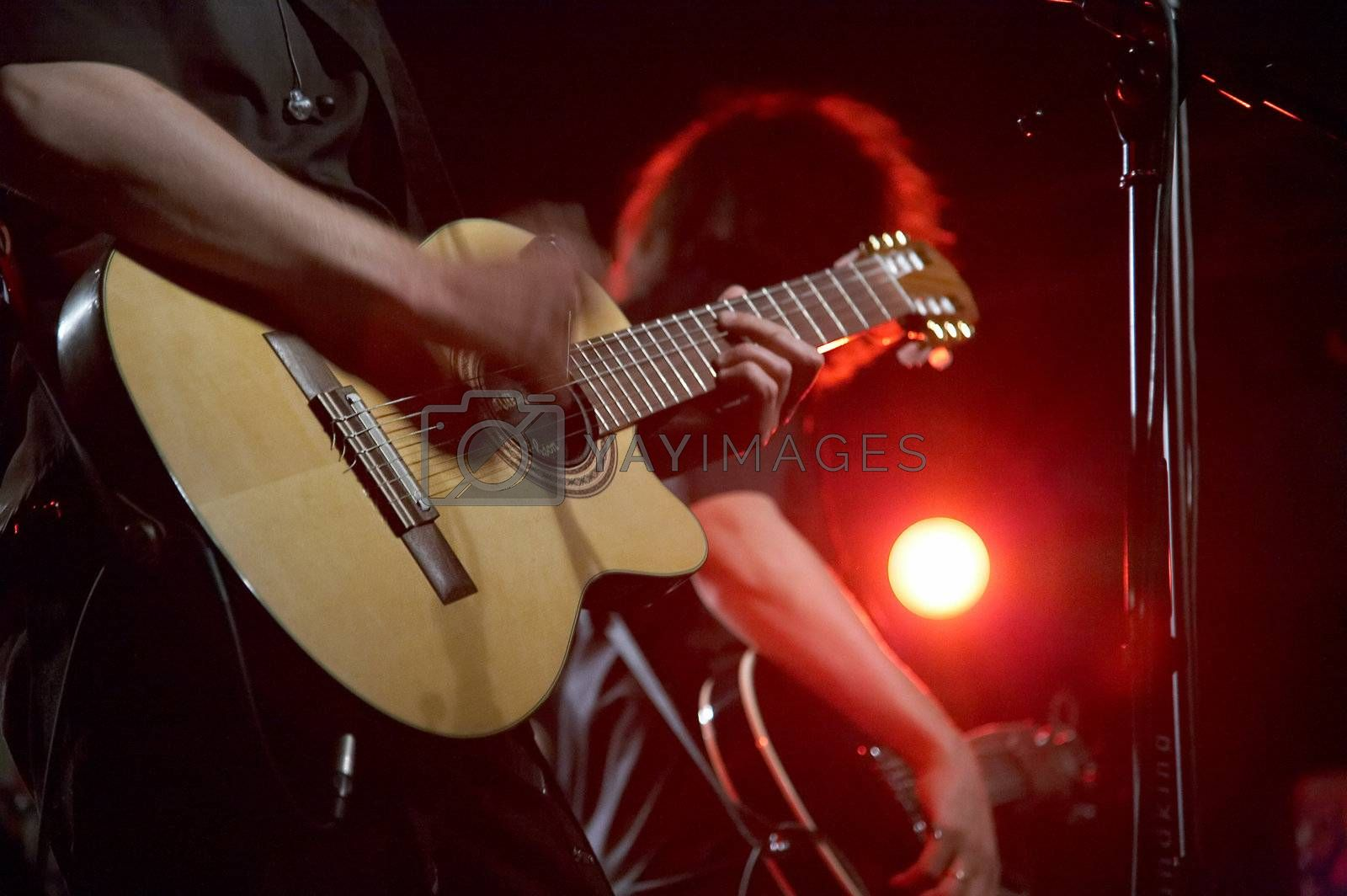 Royalty free image of Two guitarists on live concert by DeusNoxious