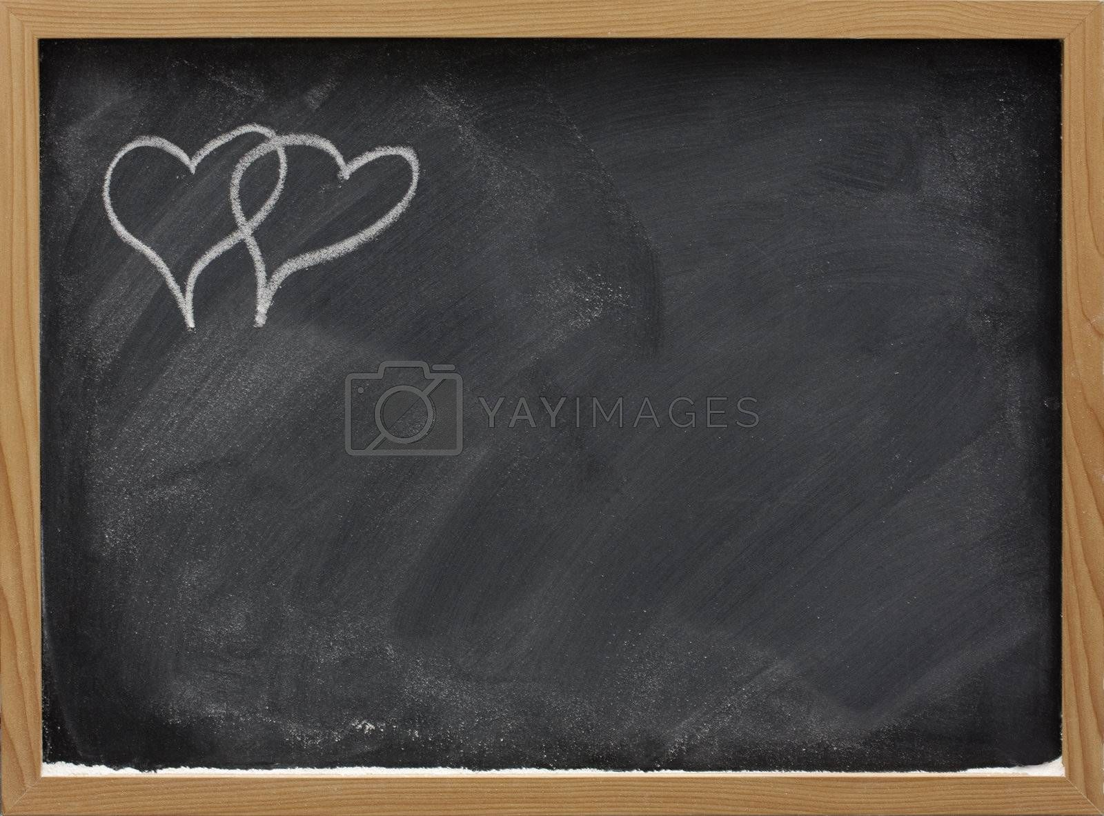 Royalty free image of be my Valentine - interlaced hearts on a blackboard by PixelsAway
