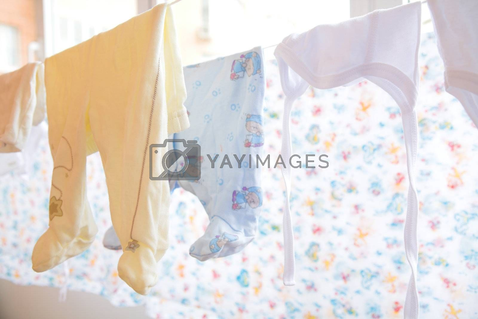 Royalty free image of baby cloth by Astroid