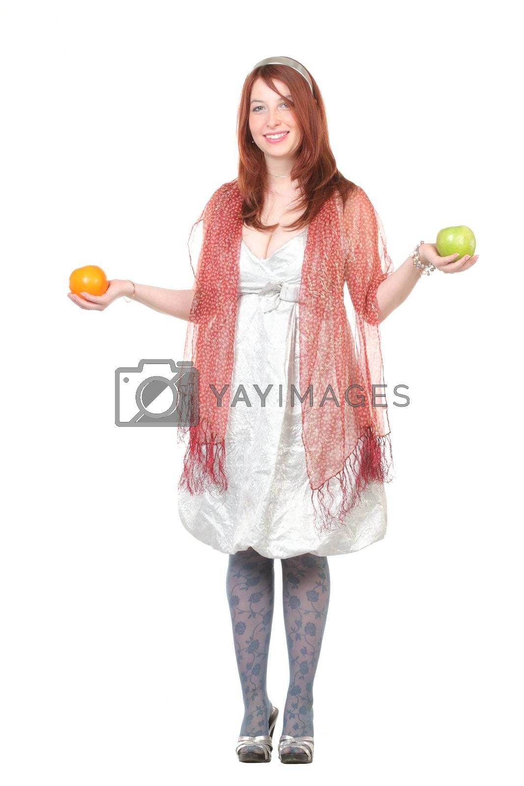 Pretty woman with fruits in hands, with copy-space