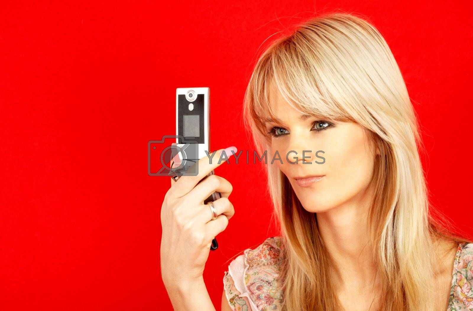 lovely blond with phone over red background