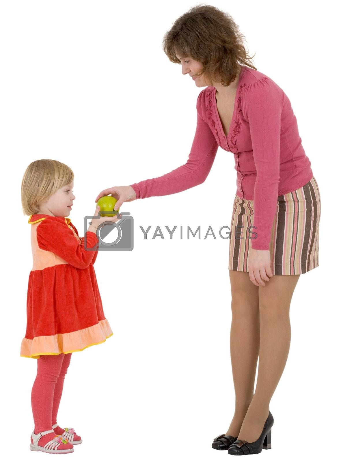 Royalty free image of Women give apple to the girl by pzaxe