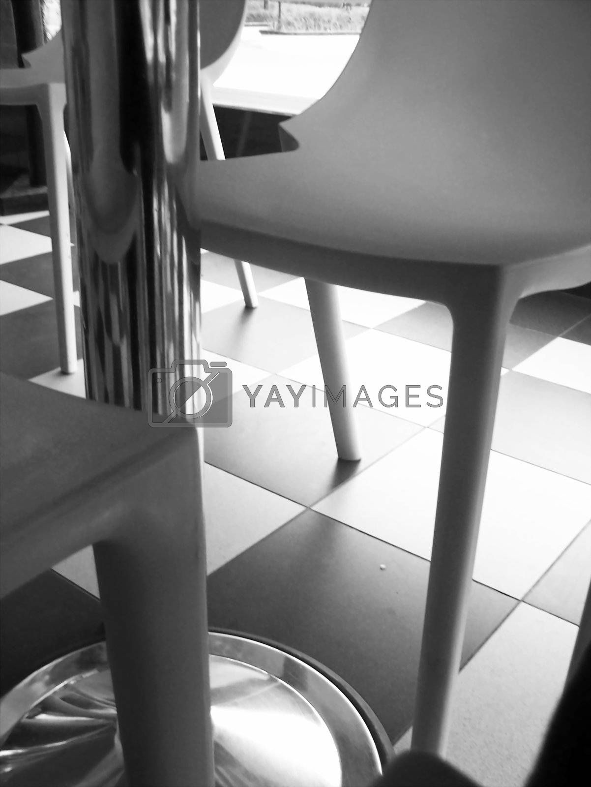 Royalty free image of Close-up of chairs underneath table by b1994mi