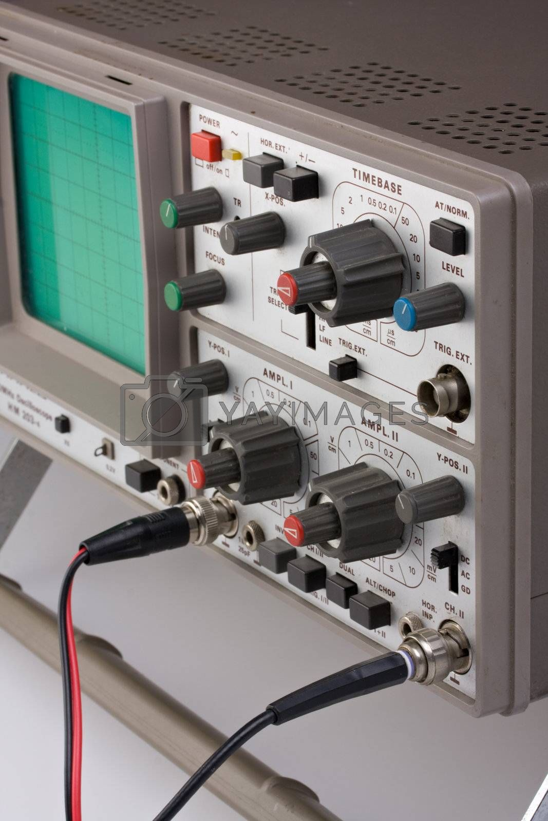 Royalty free image of analogue oscilloscope on grey background by bernjuer