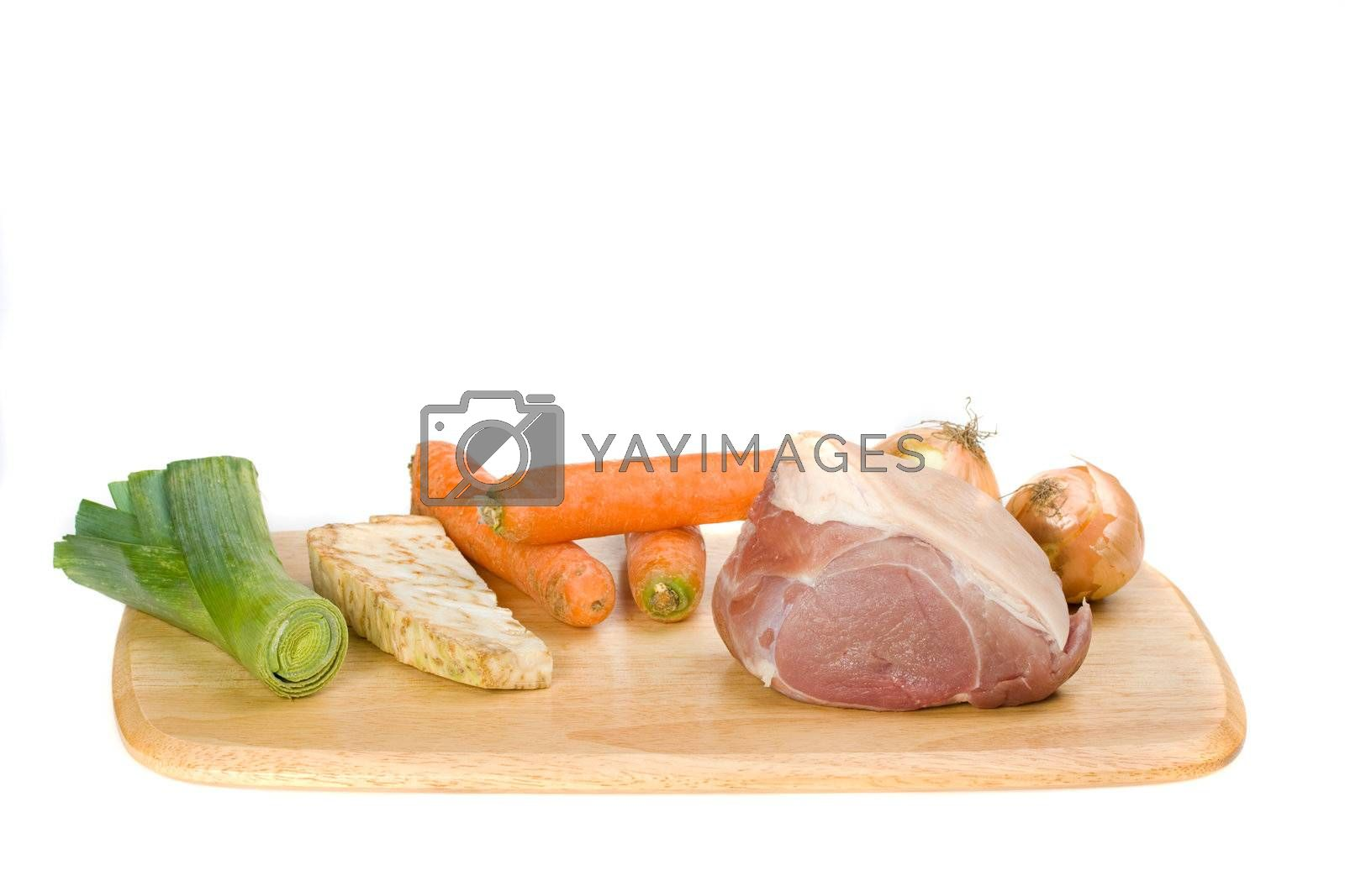 raw pork meat and sauce ingredients on a wooden plate