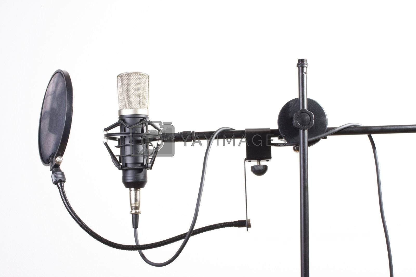Royalty free image of studio microphone on a stand on white background by bernjuer
