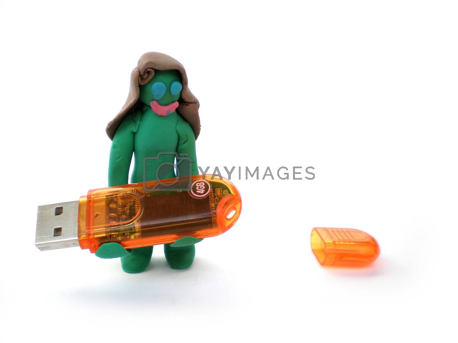 plasticine figure of a green woman carry a usb flash