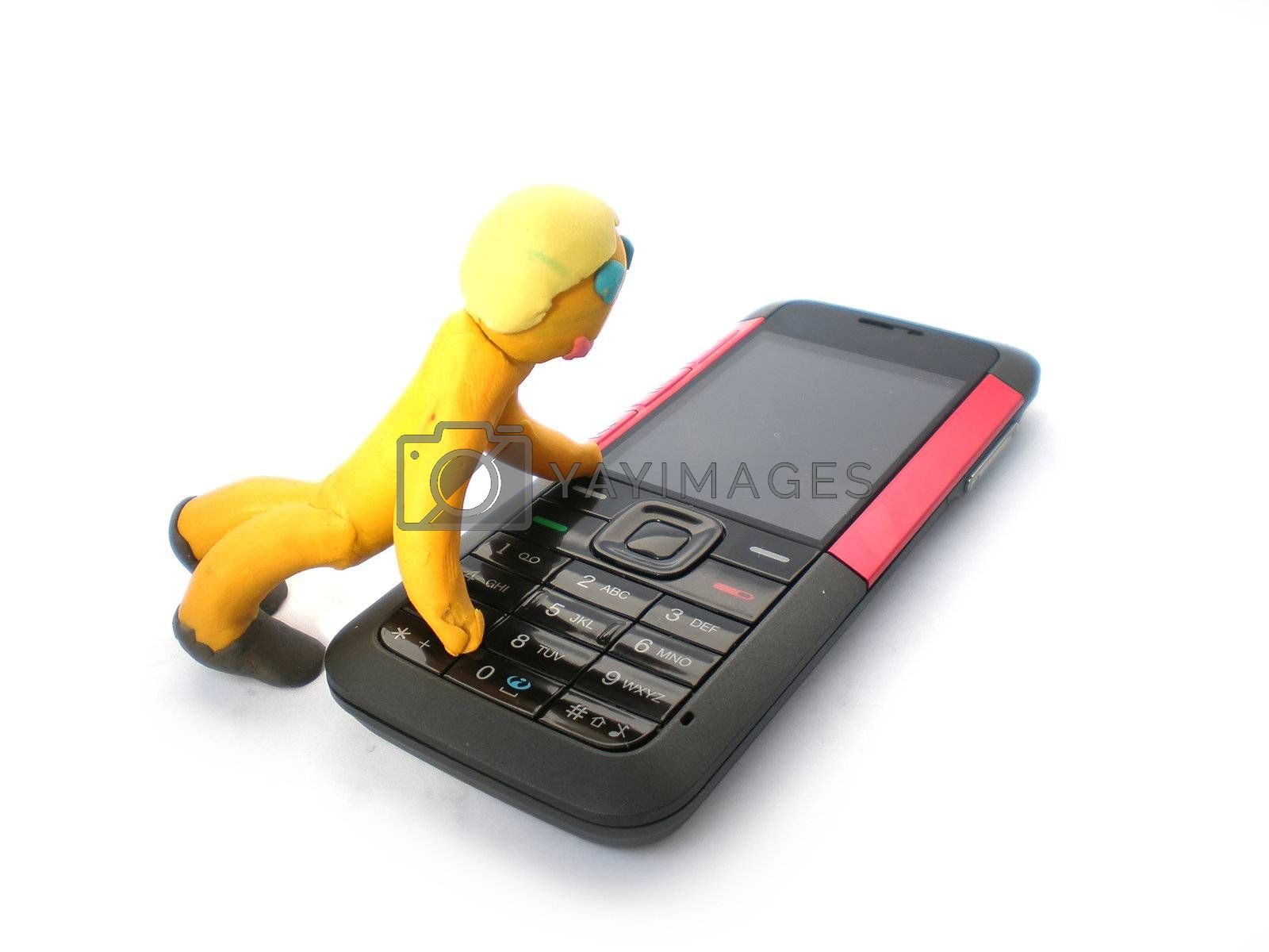 plasticine man figure with phone on white background