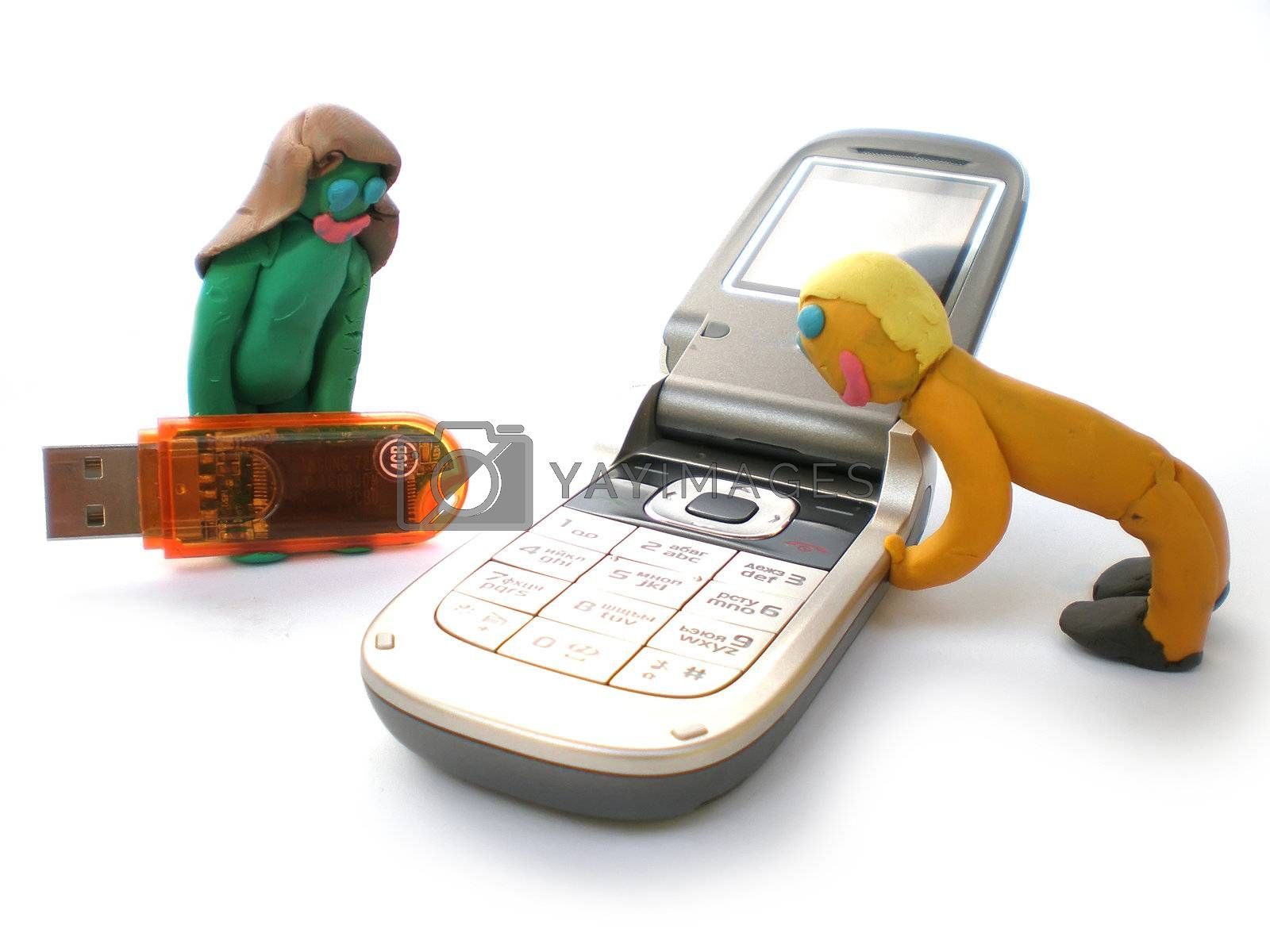 Royalty free image of plasticine people figures with phones and usb flash by Dessie_bg