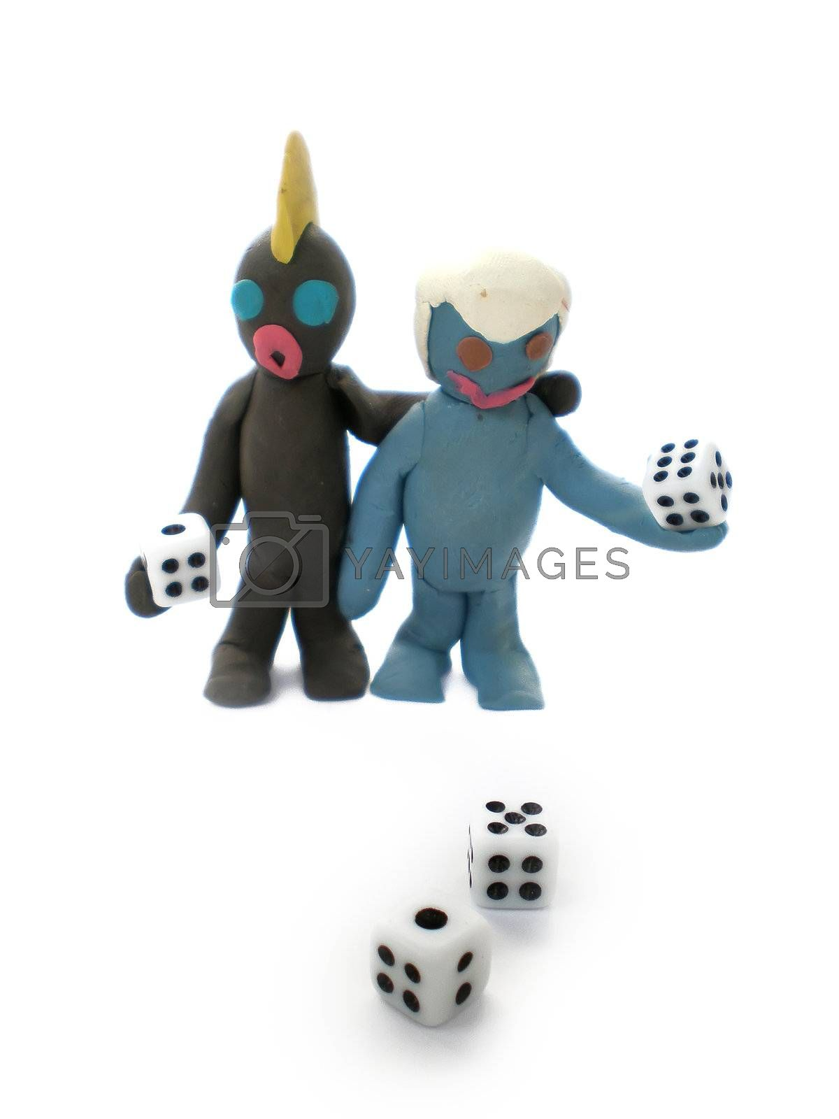 Royalty free image of plasticine people figures playing with dice by Dessie_bg
