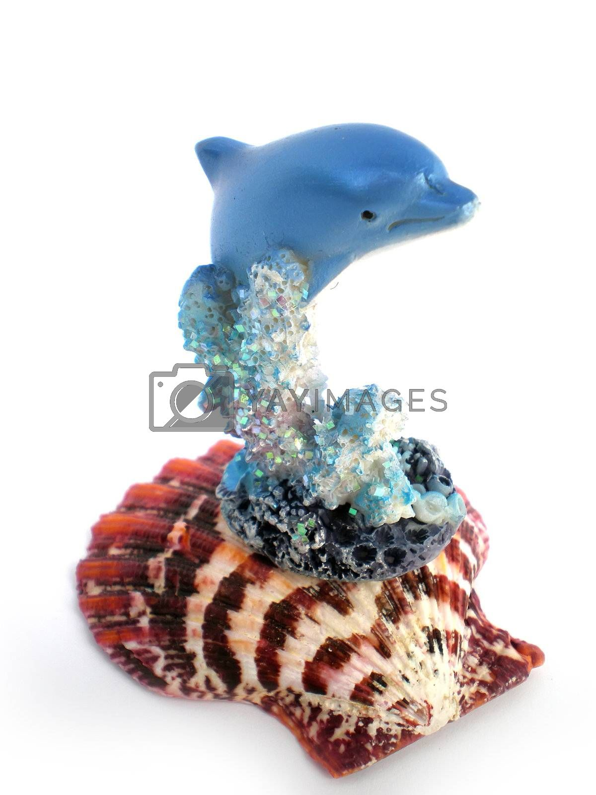 Royalty free image of dolphine statue over corals by Dessie_bg