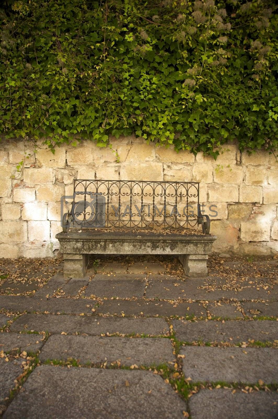 Royalty free image of old stone bench by quintanilla
