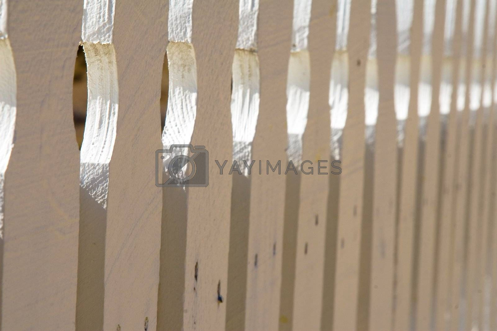 Close up of white picket fence