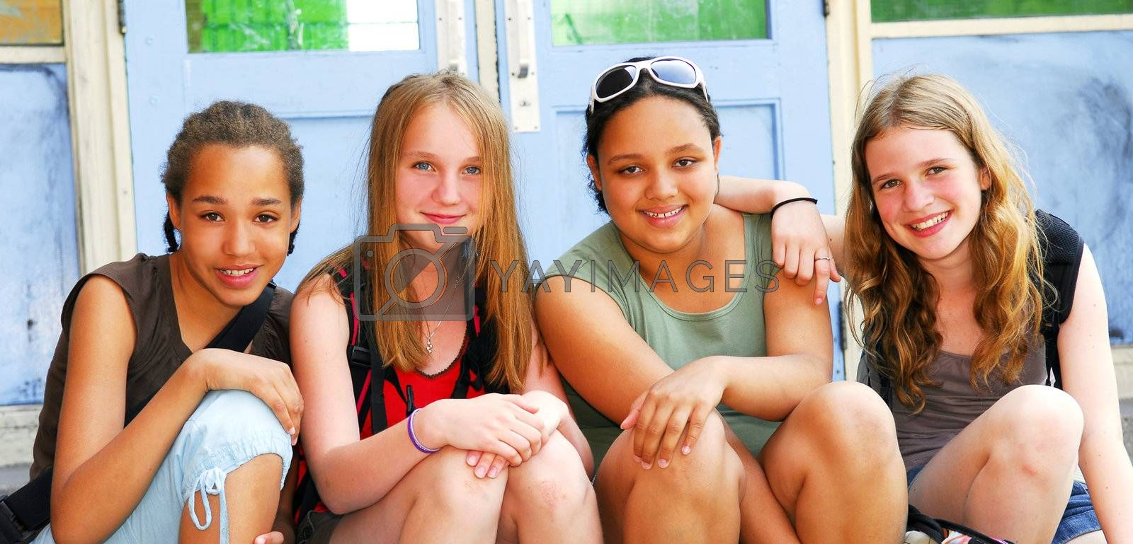 Group of young girls near school building