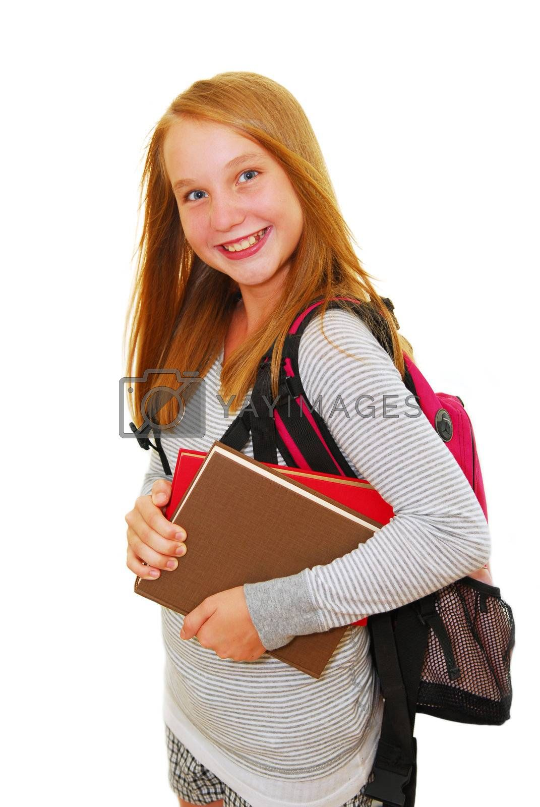 Young smiling school girl with backpack and books isolated on white background