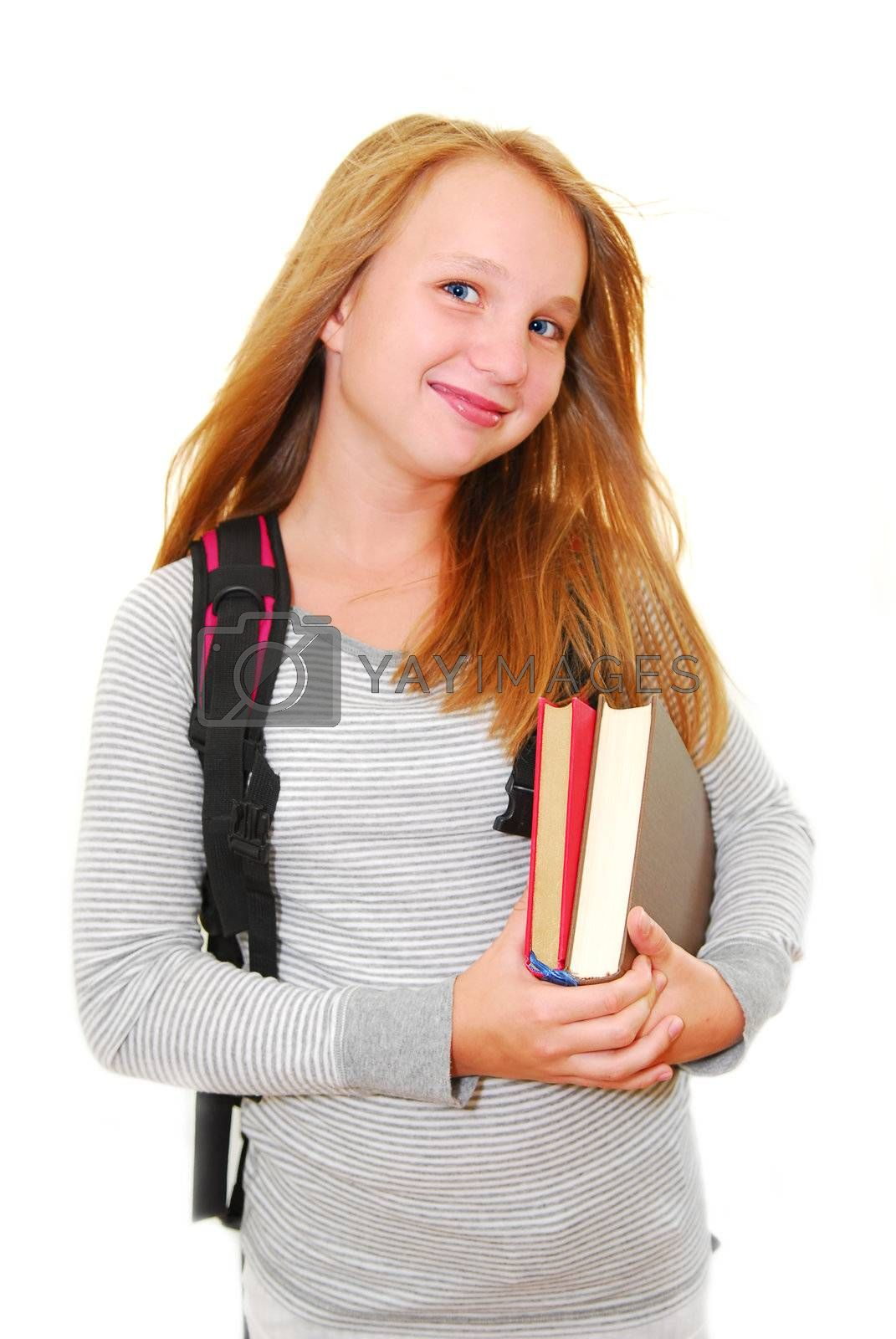 Young smiling school girl with backback and books isolated on white background