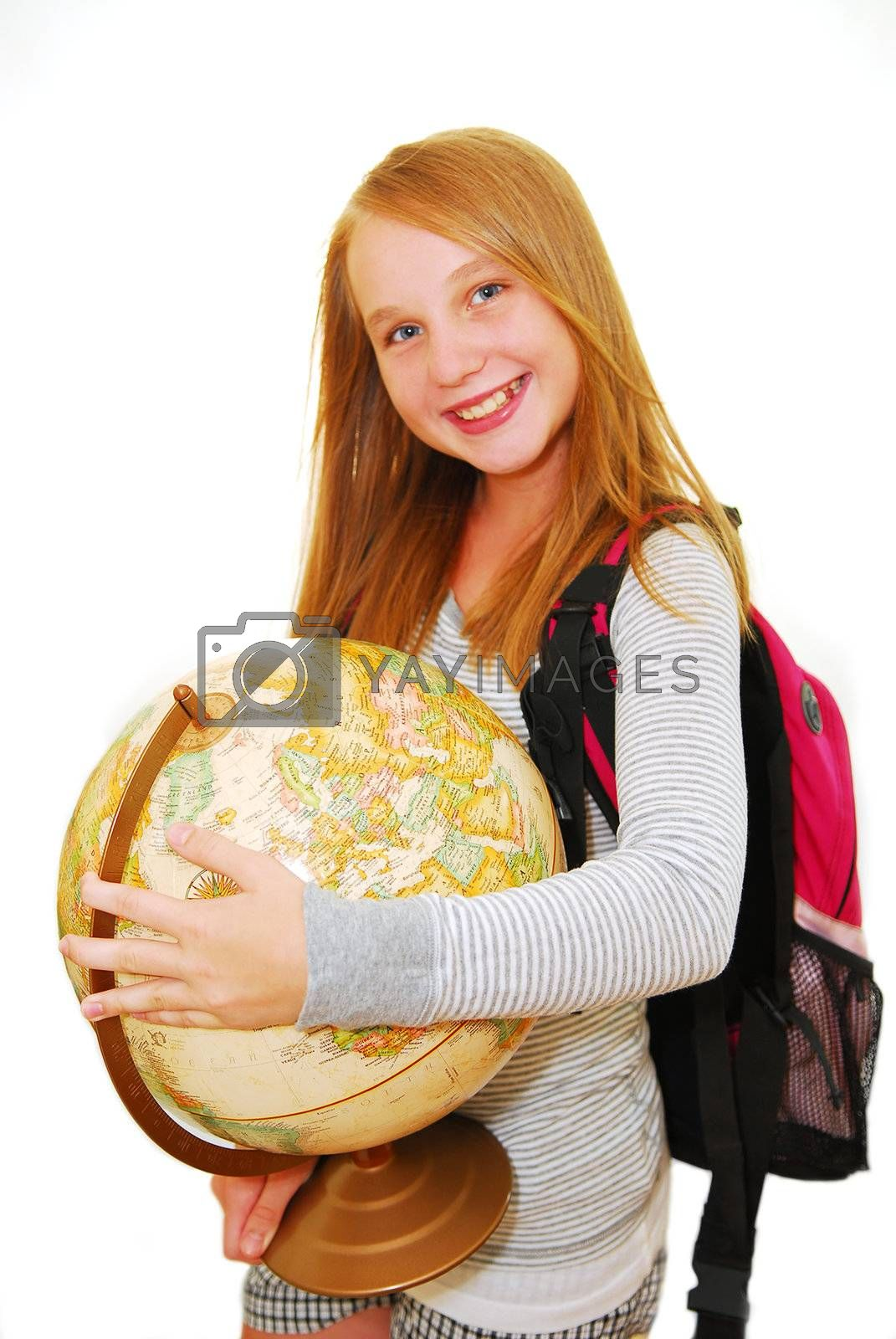 Young smiling school girl with backpack and globe isolated on white background