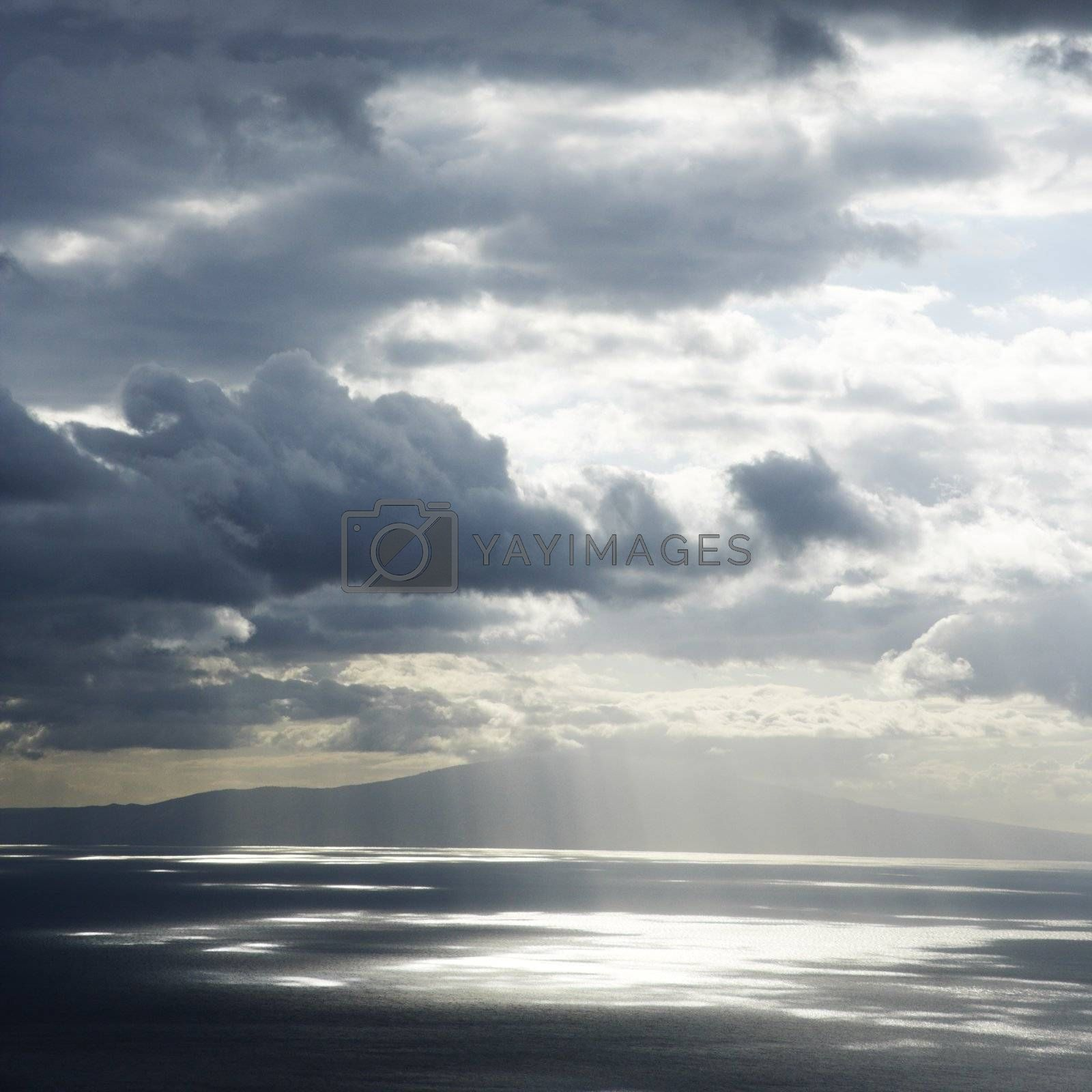 View of island in Pacific ocean with clouds from Maui, Hawaii.