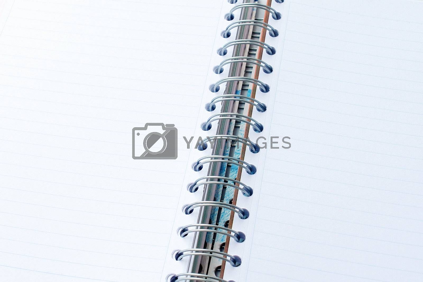 open noteboog with rings spiral on white background