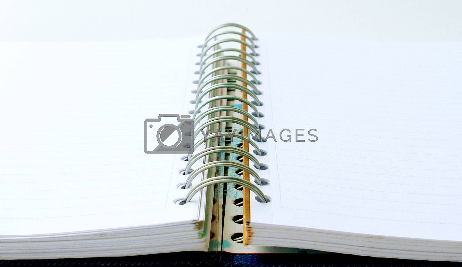 open notebook with rings on white background