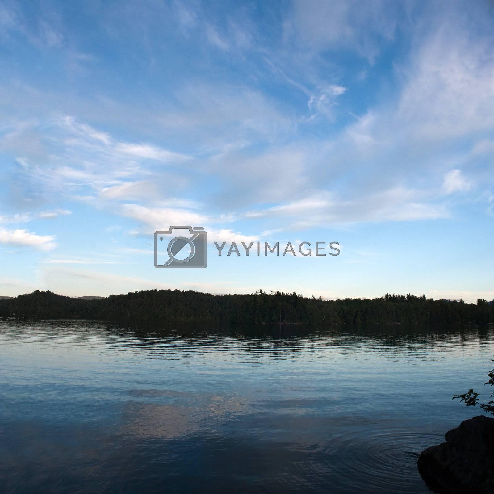 A view of lower Saranac Lake and islands located in the upstate New York Adirondacks around dusk.
