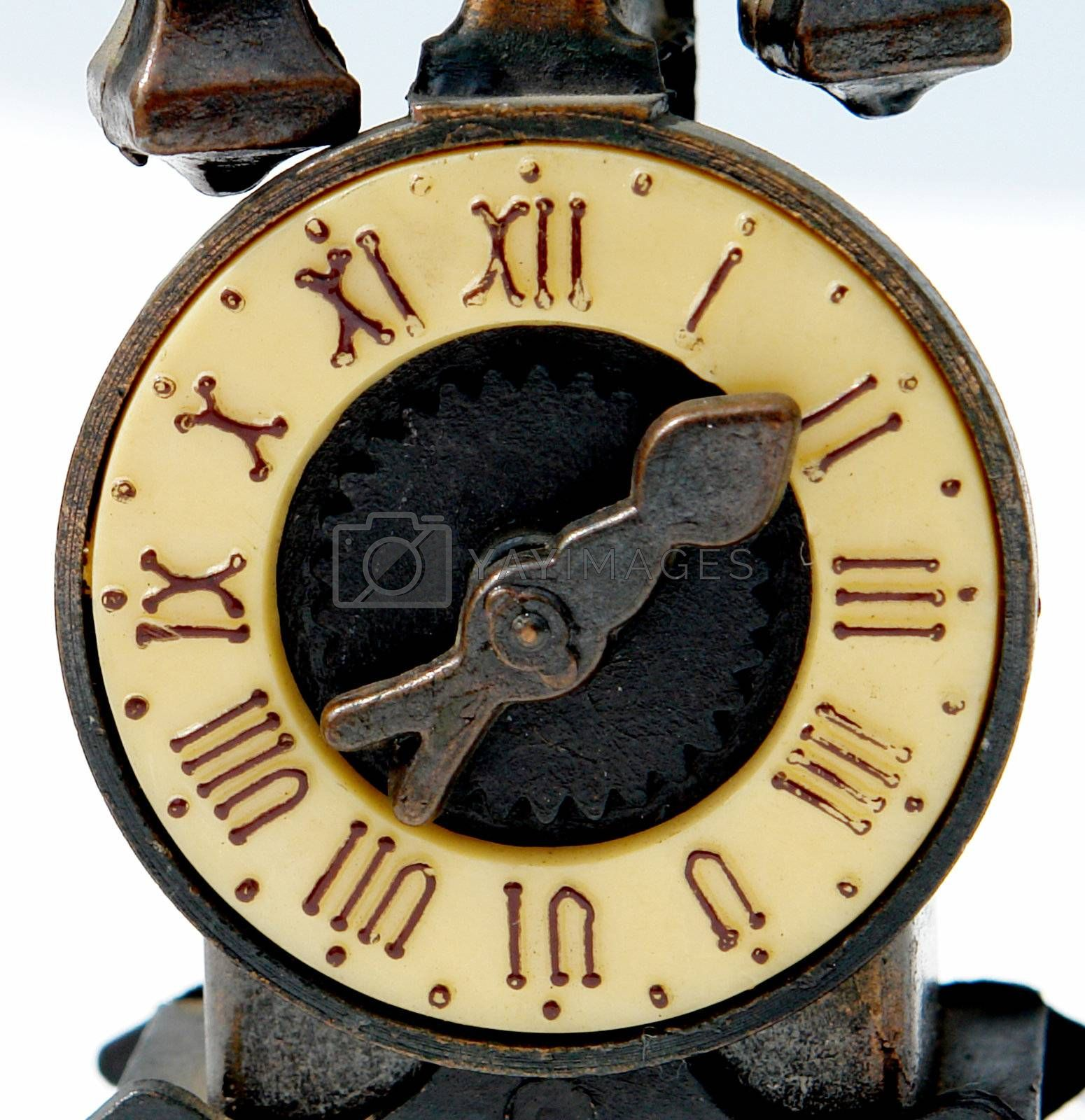 old bronze clock on white background with roman numbers