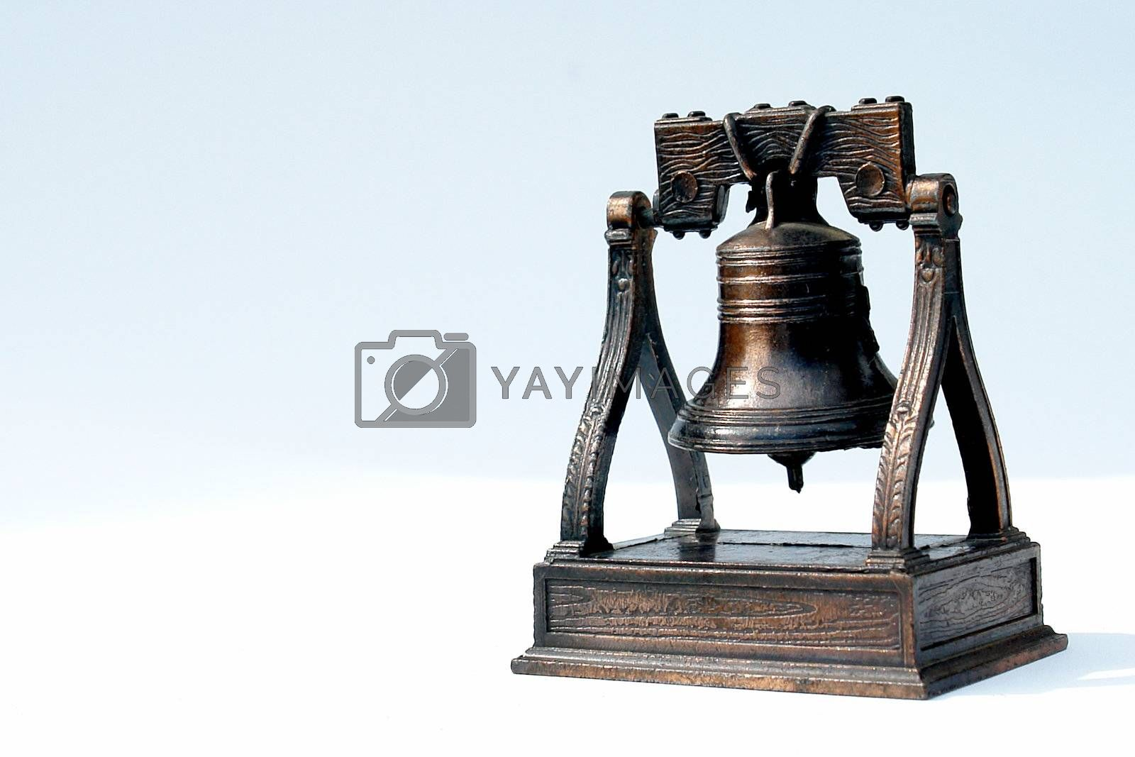 antique bell on white background, bronze texture