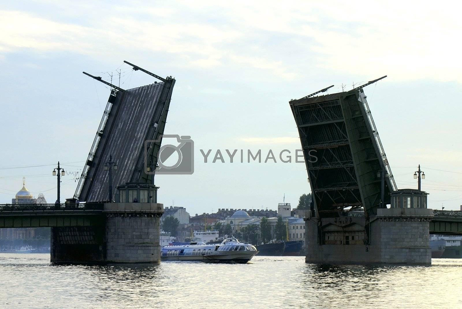 Raised Schmidt's Drawbridge over Neva river at Dusk in Saint Petersburg, Russia