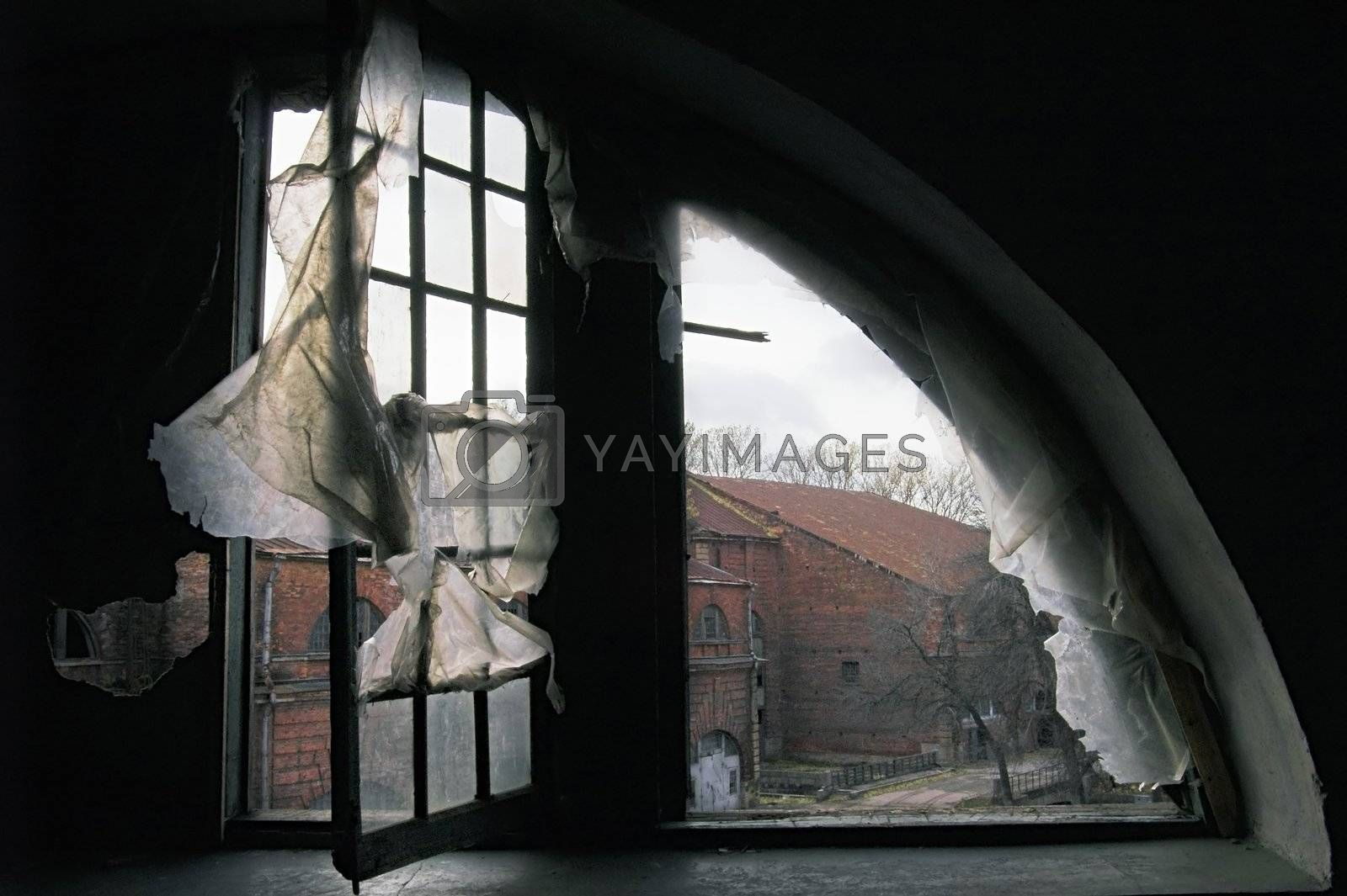 A view through a window in an abandoned house.