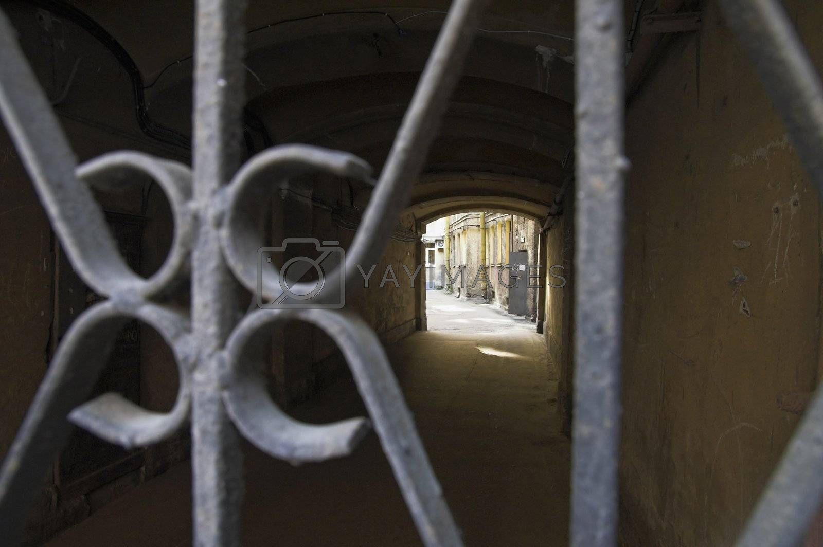 View through gates to arch passage leading to back yard