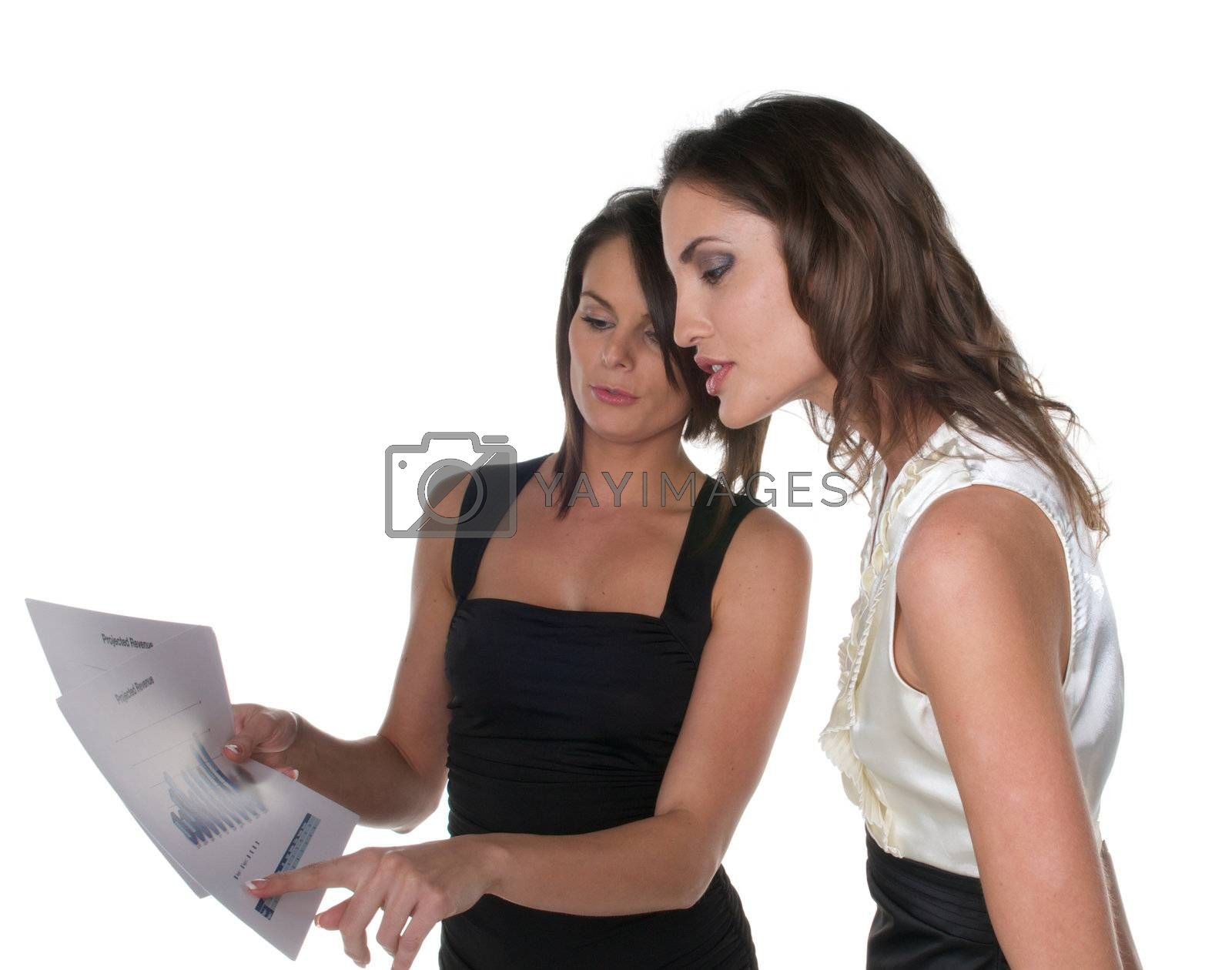 Young Caucasian female coworkers looking reports.