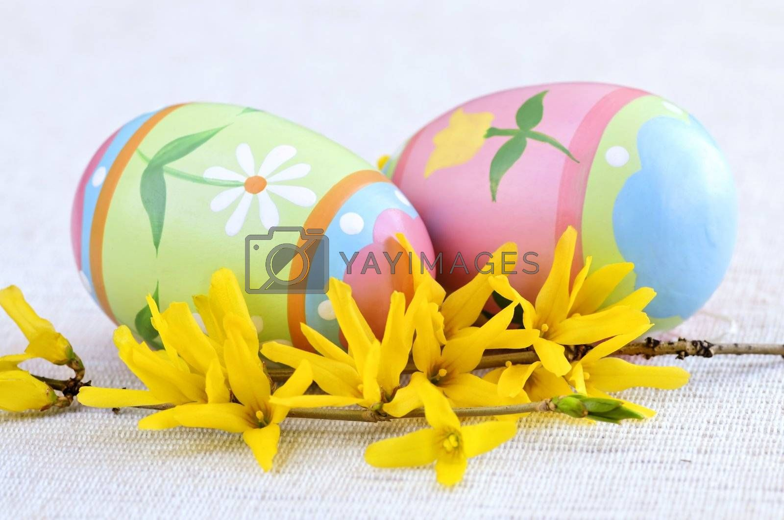 Easter eggs arrangement with yellow forsythia flowers